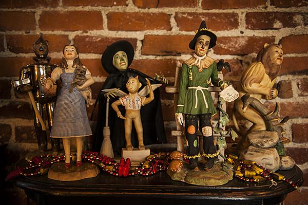 A rare set of L.E. House Goebel 'Wizard of Oz' figurines adorn a shelf.