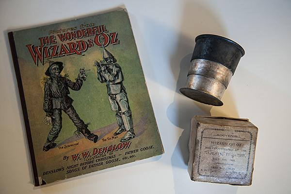 A drinking cup was a souvenir given away to audience members attending the 1903 Broadway Musical of 'The Wizard of Oz.'