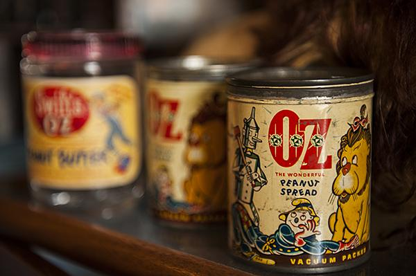 Cans of peanut spread imprinted with a 'Wizard of Oz' theme.