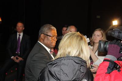Mayor Sly James answers media questions outside Tuesday's State of the City address.