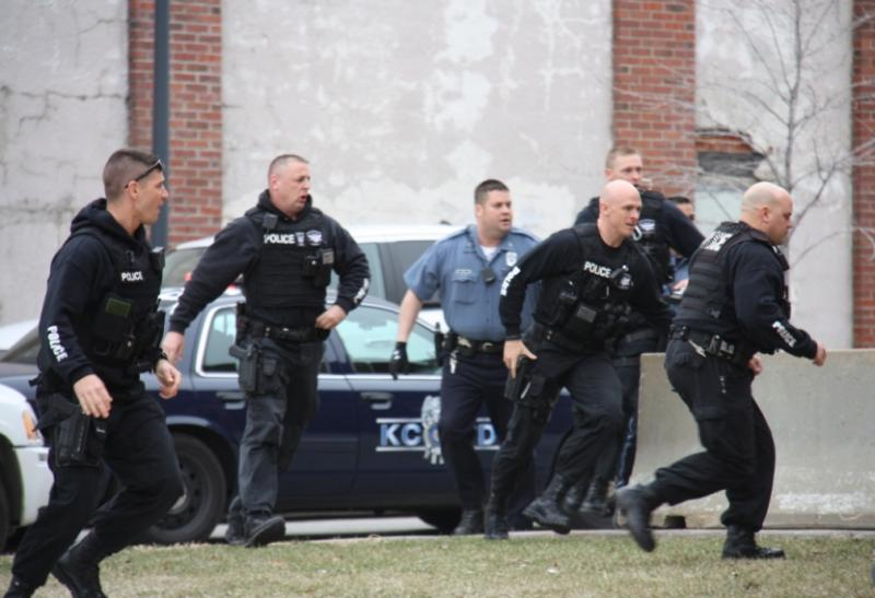 Police run inside to apprehend the man who disrupted the address.