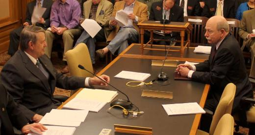 Representative Richard Carlson (Left, R-St. Marys) and Senator Les Donovan (R-Wichita) speak before the conference committee.