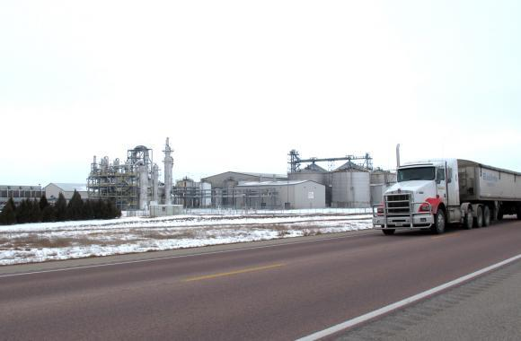 In Atkinson, Neb., a semi rolls past the NEDAK plant, which shut down when corn prices peaked during the summer of 2012 and new demand from E15 failed to materialize.