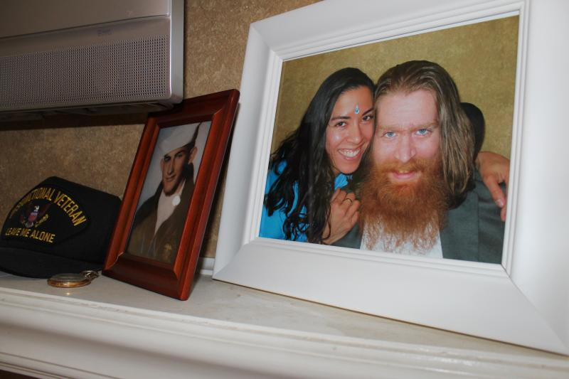Iraq war vet Tomas Young and his wife Claudia's wedding picture next to one of Tomas' step-grandfather, a Navy Seal in Vietnam.
