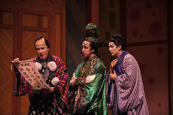 Reading an order from the great Mikado, Ruler of Japan, Ko-Ko, played by Robert Gibby Brand,  (from left) and David Kravitz, as Poo-Bah, Chris Carr as Pish-Tush, discover that a citizen must be executed.