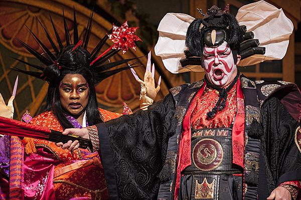 Denyce Graves, as Katisha, returns to to the village of Titipu with Dale Travis, as The Mikado.