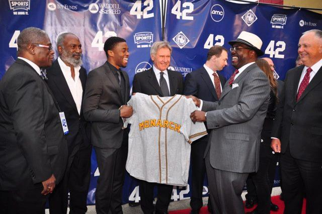 Kansas City Mayor Sly James, David Robinson (son of Jackie Robinson), actor Chadwick Boseman, actor Harrison Ford and NLBM's Bob Kendrick.