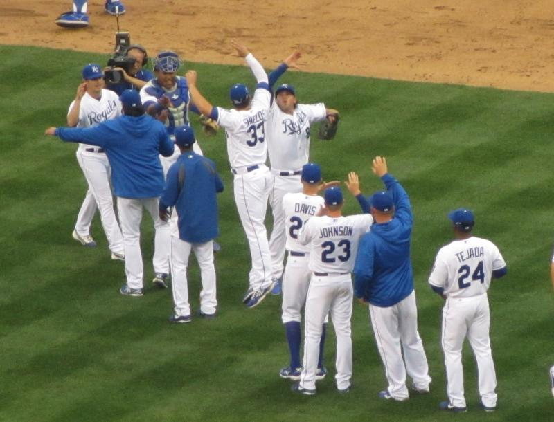 Pitcher James Shields high-fives third baseman Mike Moustakas after the Royals' win over the Twins, 3-1.