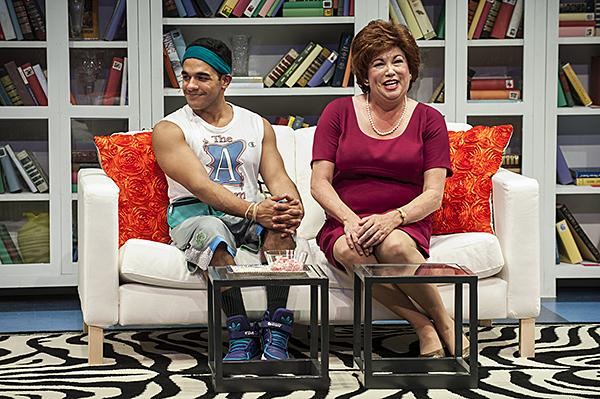 Gil Perez-Abraham Jr., as Paco, Debra Bluford, as Miss Abigail, share a couch on the set of  'Miss Abigail's Guide to Dating, Mating and Marriage.'