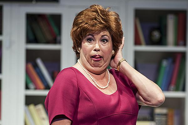 Debra Bluford, as Miss Abigail, makes a face of disapproval of modern dating methods.