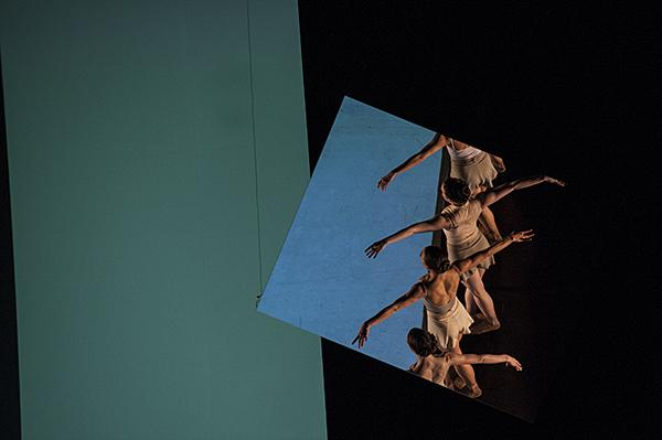 A fragment of dance is reflected in mirrors above.