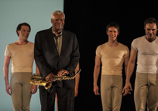 To the cheers of a small gathered crowd at the dress rehearsal, Bobby Watson stands with the dancers after a dress rehearsal.