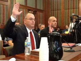 (l-r) Soc. Security investigator Keith Schilb and Special Agent in Charge Troy Turk are sworn in at a Missouri Senate Appropriations hearing on May 1st, 2013.