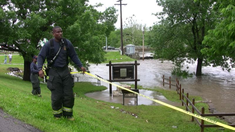 Officials taped off the banks of Indian Creek Friday due to flooding.