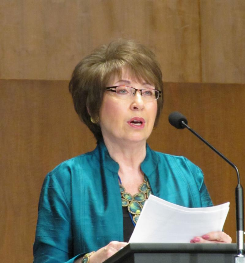 Apostle Linda Booth reads new policy recommendations at 2013 conference
