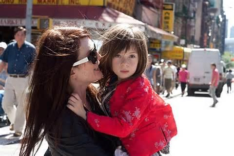 "Julianne Moore and Onata Aprile as mother and daughter in ""What Maisie Knew."""