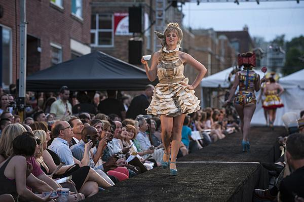 A model walks the runway in a coffee filter dress by Lyndsey Helling.