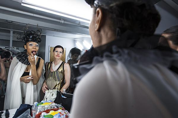 Looking in the mirror, model Bri Davis (from left) and LaRae Shanks check their makeup wearing clothing by Paige Beltowski.