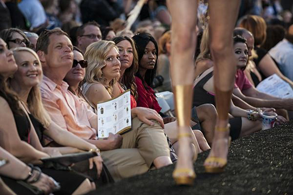 Models receive an appraising stare from members of the audience.