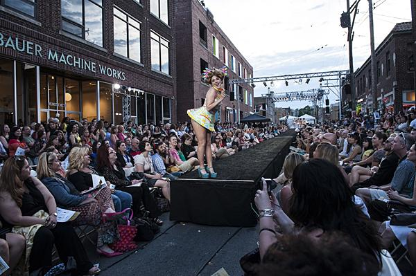 Crowds lined 18th Street to take in the show as model Caitlin Corcoran struck a pose wearing a TCBY miniskirt and plastic spoon headdress.