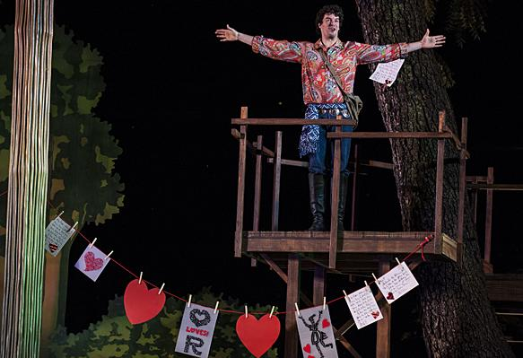 Declaring his love for Rosalind, Todd Carlton Lanker, as Orlando, covers trees with his verses of affection.