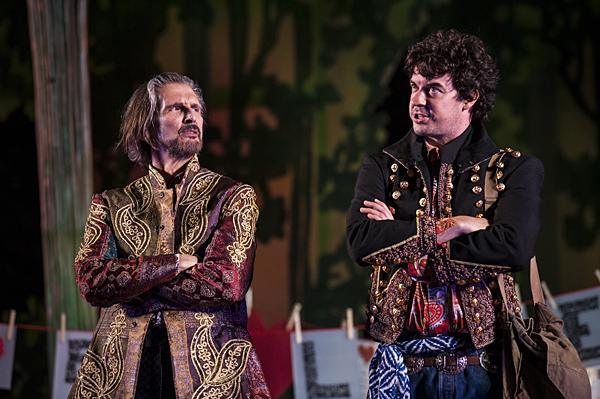 Bruce Roach, as Jaques, and Todd Carlton Lanker, as Orlando, verbally spar in the Forest of Arden watched by Rosalind.