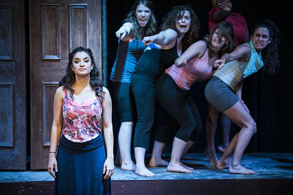Megan Herrera, as Lysistrata, attempts to bring together women from both sides of the war to join them in their sex strike.