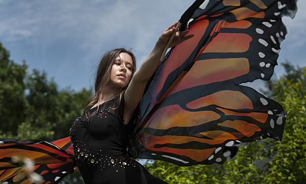 Silk wings outstretched, Gwynedd Vetter-Drusch flutters through the butterfly habitat at Monarch Watch.