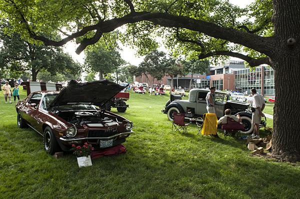 Car enthusiasts gathered beneath the elegant ginkgo trees on the campus of the Kansas City Art Institute.