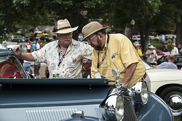 Bill Alexander (from left) and Kermit Wilson look under the hood of a 1935 Riley Kestrel 22T 4-Lite Saloon.