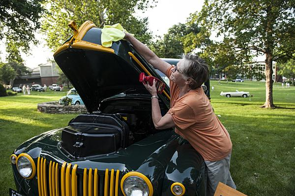 Marilyn Blackmon polishes a 1946 Ford half ton pick-up.  Wayne and Marilyn Blackmon named the truck 'Lil Henry.' The truck was rescued from a field in Northern Minnesota.