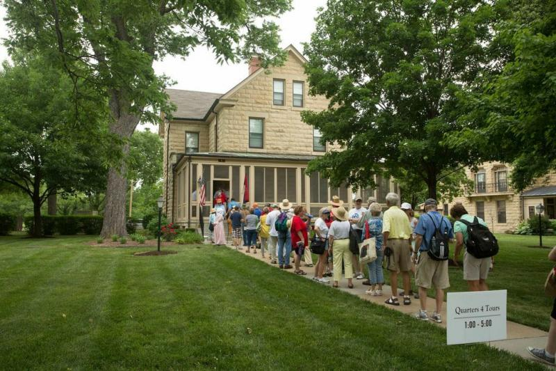 A crowd lines up to tour the home of Maj. Gen. Paul Funk.