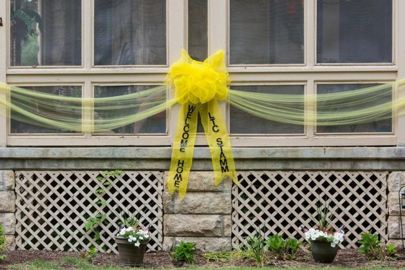 The front of Lt. Col. Charles Stamm's home was decorated in honor of his arrival home. A group from Fort Riley returned the day before the Symphony.