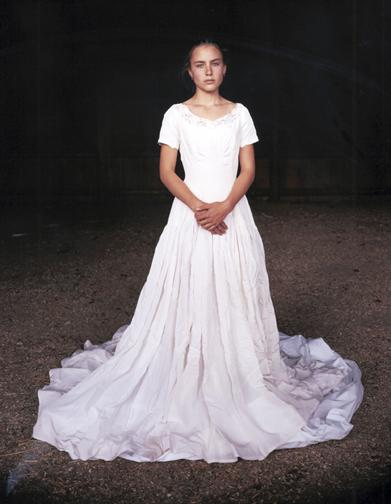 Mattie in Her Grandmother's Wedding Dress, Laverty Ranch, Custer County, Idaho, 2005; chromogenic print, 96 x 72 inches.