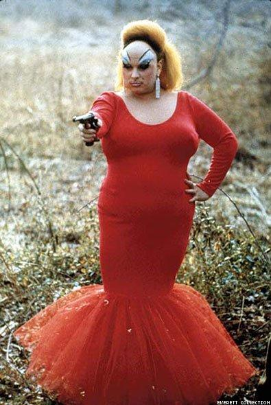 "Divine in an iconic pose from the movie that made her a star: John Waters's ""Pink Flamingos."""