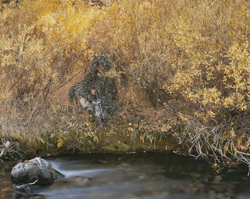 Isaac Babcock, Biologist for the Nez Perce Tribe, Dressed for Tranquilizing and Radio-Collaring Wolves, Fourth of July Creek, Custer County, Idaho, 2003; chromogenic print, 72 x 96 inches.