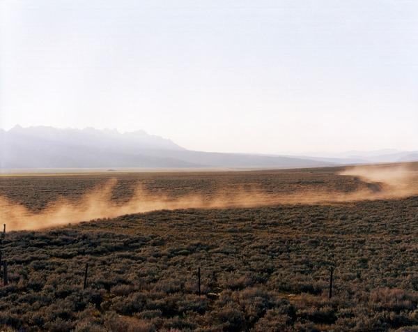 One Car Passing, Valley Road, Sawtooth Valley, Idaho, 2003; chromogenic print, 72 x 96 inches.