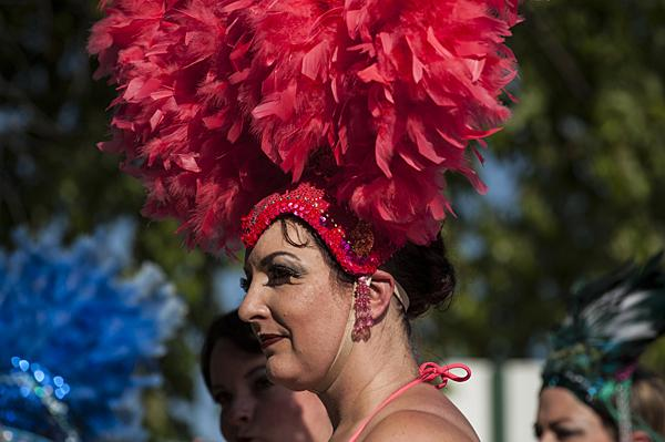 Feathered headdresses line the sidewalk as a burlesque troupe prepared to walk the red carpet to kick off the ninth annual Annual Kansas City Fringe Festival.