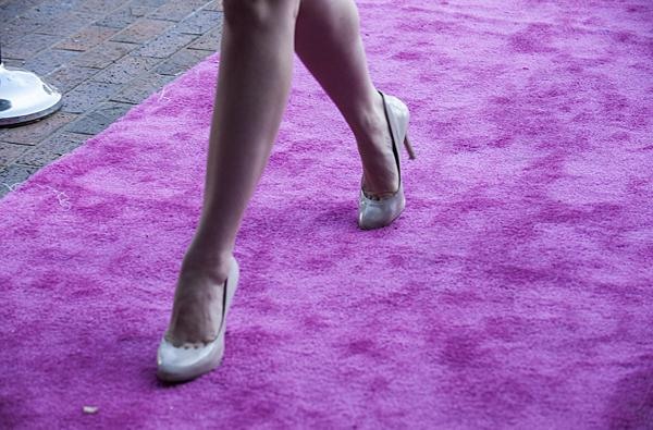 Sporting high heels, choreographer Erin Muenks  who will be performing in the 'Erin Muenks - Choreography Showcase' arrives at the festival's opening night.