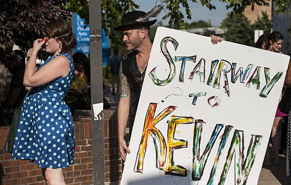 Kevin Thornton waits in line carrying a sign announcing his show 'Stairway To Kevin.'