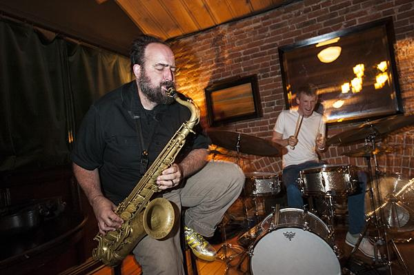 Mark Southerland, on saxophone and Brian Steever on drums perform as part of an improvisational jazz trio upstairs at Grünauer.