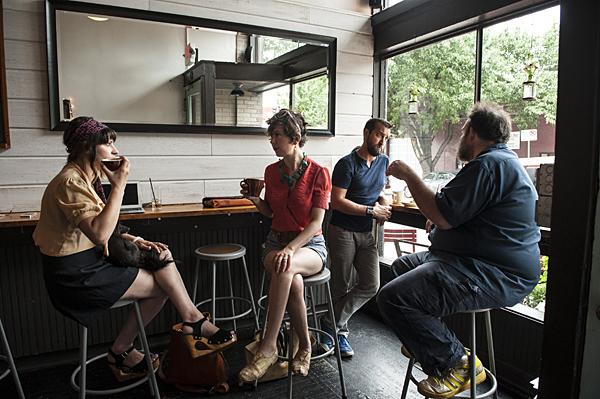 A chance meeting at Little Freshie, a Westside coffee shop, ignited an intense morning conversation between Danielle Meister (from left)and Peregrine and Matthew Tady and Mark.