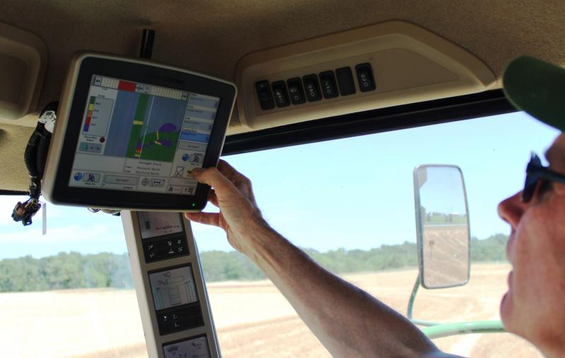 Kermit Kalb at the controls of his combine.