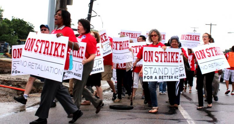 Minimum wage strike backers march on Kansas City restaurant.