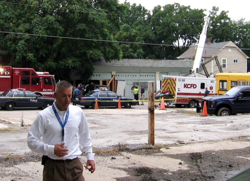 KC firefighters shore up remains of damaged daycare center, Police Captain Tye Grant in foreground.