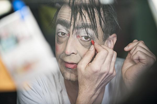 Megee skillfully applies makeup as he prepares for his role as Mr. Grumps, in Lyle the Crocodile at the Coterie.
