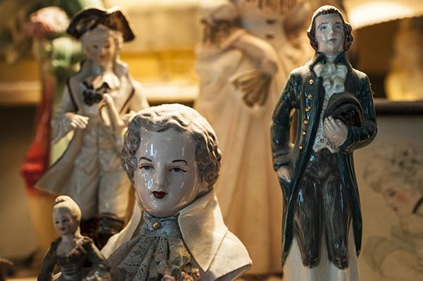 "Megee and Fulton Adams collect ""dandies"" or ceramic statuettes missing their female companions."