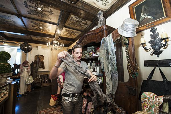 Looking through the store's collection of accessories, Fulton Adams discovers a scarf decorated with a skull by Faliero Sarti at Churchill in Fairway, Kan.