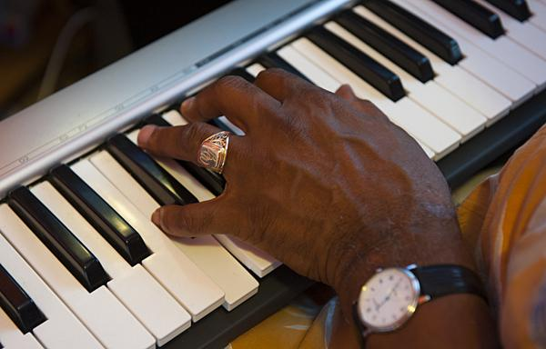 Watson works out a tune on his keyboard.