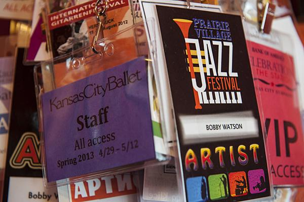Tokens from the many jazz festivals Watson has performed in hang from a nail on the wall.